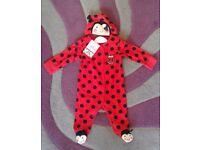 New girl's ladybird sleepsuit 6/9 months