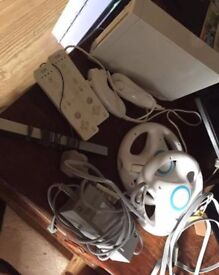 Nintendo Wii several controllers and games