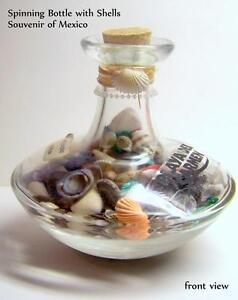 Pear shaped Spinning Bottle with sea shells, souvenir of Mexico