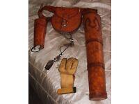 Archery quiver, bag, belt and arm brace.