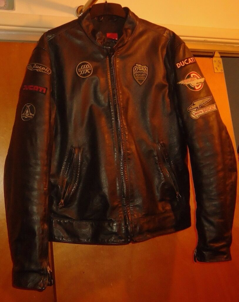 DUCATI RETRO UNISEX LOGO PATCH LEATHER JACKET By Dainesein Downend, BristolGumtree - Cost £280.00 new.Very little use and wear. Beautifully made and well kept. No longer a Ducati owner... 42 chest/bust approx £150.00 May consider swap/px for an electric guitar? Calls only please