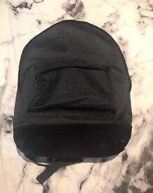 MiPac all black backpack with velvet bottom detail. BRAND NEW