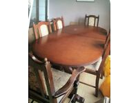 solid wood dark table and 8 chairs.