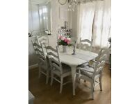 White farmhouse dining table and 6 chairs