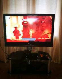 """Sony bravia 40"""" tv with black tempered glass stand"""