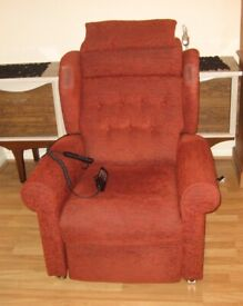 A Top Quality Massaging/Vibrating Electric Riser Recliner Wingback Armchair.