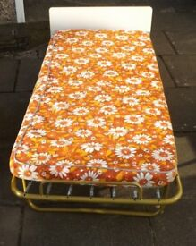 Single fold up bed with mattress. In good condition. Buyer to collect.