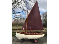 Lug sail sailing dinghy.