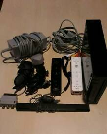 Nintendo wii with 2 games and fit board