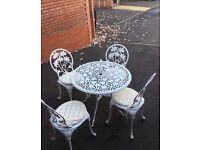 Garden table/patio set Vintage style, white, metal patio table with four chairs.