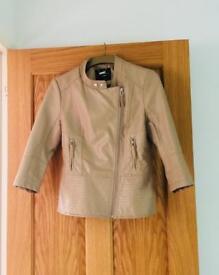 Jane Norman tan jacket.