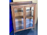Antique Display Cabinet. Solid Oak/ Glass front. Good Condition.