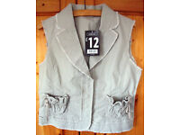 ** NEW ** and un-worn George natural coloured sleeveless jacket/waistcoat. Size 12.