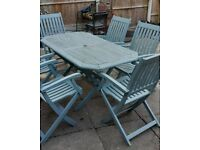 SOLID WOODEN PATIO TABLE with SIX SOLID WOODEN FOLDING PATIO CHAIRS