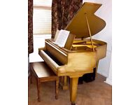 Andreas Christensen baby grand piano