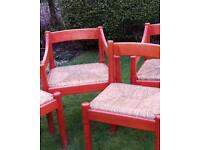 Habitat red solid wood chairs with rattan seat pads - 2 of which are carver chairs