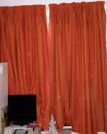 """Pair of lined M & S curtains each one is 66"""" wide x 72"""" drop"""