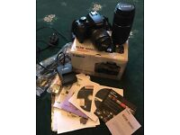 Canon 1000d SLR with accessories.
