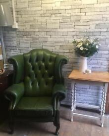 Antique green leather chesterfield armchair/wingback