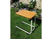 Overbed adjustable height tilting table