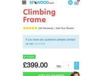 Wooden climbing frame and swings
