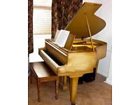baby grand piano in good playing condition bench included