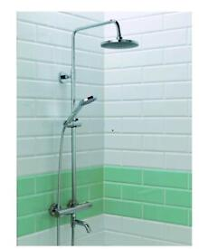 Shower mixer with dual heads and water spout