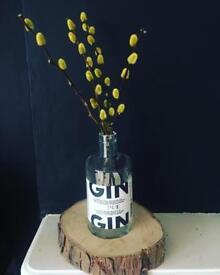 Gin bottle vases set in pine logs