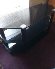T.V. stand black glass