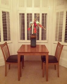 Pine table and 2 chairs. Perfect condition.