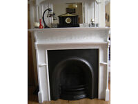 Cast iron metal Victorian Edwardian type fire place fireplace and wooden surround mantle mantlepiece