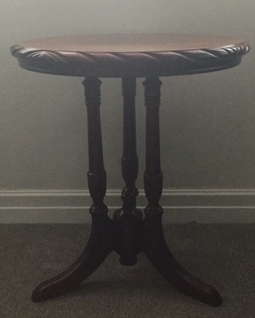 Solid Mahogany 3 legged round lamp table by John E Coyle. Rope edged design.