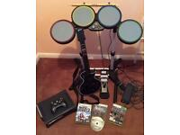 Xbox 360 with Rockband drums and guitar
