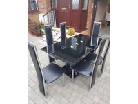 6 seater black/glass/leather dining room table