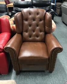 Real leather brown Fireside recliner chair