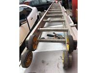 2 x very long ladders 12' feet on wheels