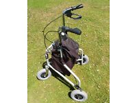 3 wheel folding Rollator with brakes and bag. Provides stability while walking.