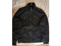 Black jacket for men. 'Lost' surfing brand.