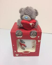 Tatty teddy bear with mug
