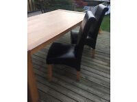 Solid oak dining table & 4 brown faux leather chairs