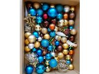 Box of various Christmas tree decorations