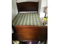 Dark wood antique double bed frame