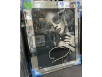 Lady wearing designer glasses & jewels with liquid art, crystals and mirror frame picture