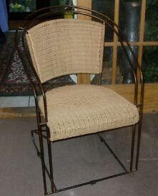 SPRINGY ARM CHAIR WICKER SEAT AND BACK NO SPRINGS BUT DESIGN OF CHAIR
