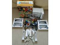 Wii + 14 games inc mario kart, skylanders + family trainer
