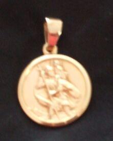 Solid Hallmarked 9ct gold round St Christopher. Weight 3.4 g