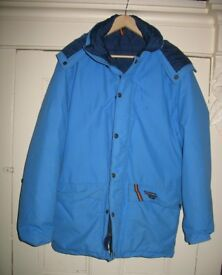 Phoenix Goretex Coat, light blue in colour.