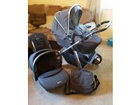 Silvercross pioneer Pram And Car Seat travel system with accessories.