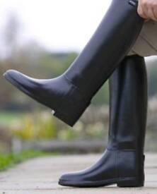 Long black ridding boots