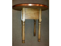 Vintage hammered copper coffee table with storage compartment